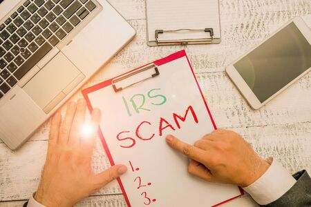 Conceptual hand writing showing Irs Scam. Concept meaning targeted taxpayers by pretending to be Internal Revenue Service