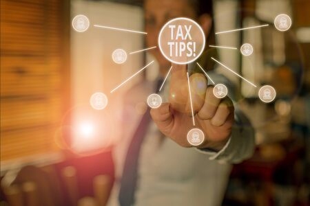Conceptual hand writing showing Tax Tips. Concept meaning compulsory contribution to state revenue levied by government Woman wear suit presenting presentation using smart device