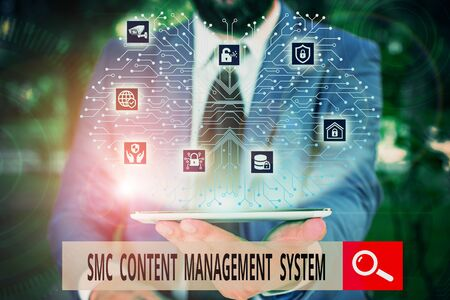Conceptual hand writing showing Smc Content Management System. Concept meaning analysisgae creation and modification of posts Male wear formal work suit presenting presentation smart device