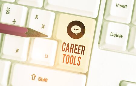 Writing note showing Career Tools. Business concept for the system designed to assist and enhance your career White pc keyboard with note paper above the white background