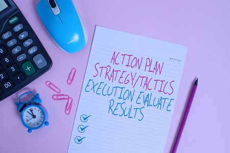 Writing note showing Action Plan Strategy Ortacti. Business concept for Action Plan Strategy Or Tactics Execution Evaluate Results Calculator clips alarm clock mouse sheet pencil colored background