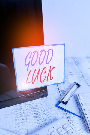 Writing note showing Good Luck. Business concept for A positive fortune or a happy outcome that a demonstrating can have Note paper taped to black computer screen near keyboard and stationary