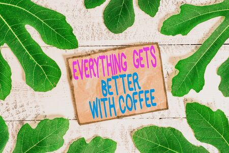 Writing note showing Everything Gets Better With Coffee. Business concept for Have a hot drink when having problems Foto de archivo