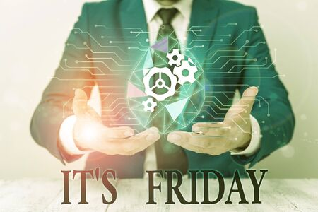 Writing note showing It S Friday. Business concept for Last day of the working week Before Saturday or weekends Male human wear formal suit presenting using smart device