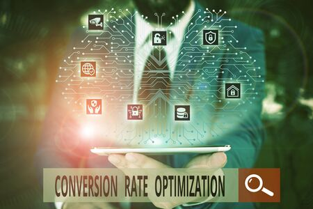 Conceptual hand writing showing Conversion Rate Optimization. Concept meaning system for increasing percentage of visitors Male wear formal work suit presenting presentation smart device