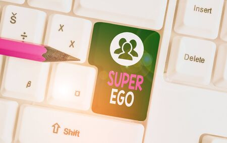 Text sign showing Super Ego. Business photo text The I or self of any demonstrating that is empowering his whole soul White pc keyboard with empty note paper above white background key copy space