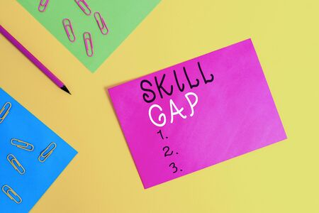 Word writing text Skill Gap. Business photo showcasing Refering to a demonstrating s is weakness or limitation of knowlege Blank paper sheets message pencil clips binders plain colored background