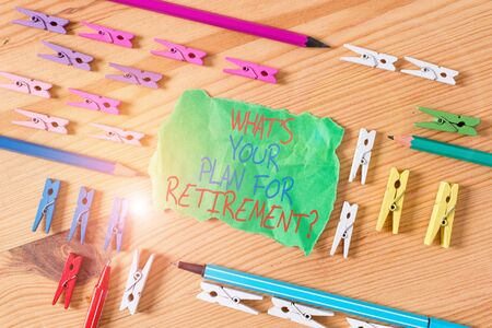 Writing note showing What S Your Plan For Retirement Question. Business concept for Savings Pension Elderly retire Colored clothespin papers empty reminder wooden floor background office Stock Photo