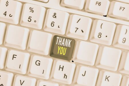 Word writing text Thank You. Business photo showcasing replaying on something good or greetings with pleased way White pc keyboard with empty note paper above white background key copy space