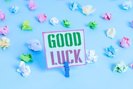 Word writing text Good Luck. Business photo showcasing A positive fortune or a happy outcome that a demonstrating can have Colored crumpled papers empty reminder blue floor background clothespin