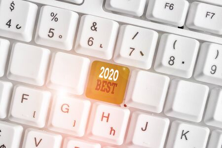 Word writing text 2020 Best. Business photo showcasing Highest quality done in all fields preparing for the next year White pc keyboard with empty note paper above white background key copy space Stock Photo