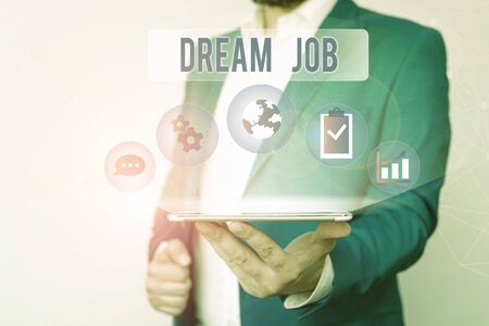 Text sign showing Dream Job. Business photo text An act that is paid of by salary and giving you hapiness Male human wear formal work suit presenting presentation using smart device 写真素材