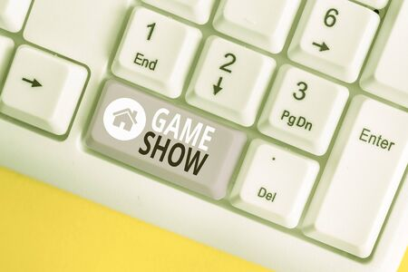 Word writing text Game Show. Business photo showcasing Program in television or radio with players that win prizes White pc keyboard with empty note paper above white background key copy space 版權商用圖片