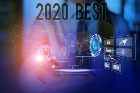 Conceptual hand writing showing 2020 Best. Concept meaning Highest quality done in all fields preparing for the next year Woman wear work suit presenting presentation smart device