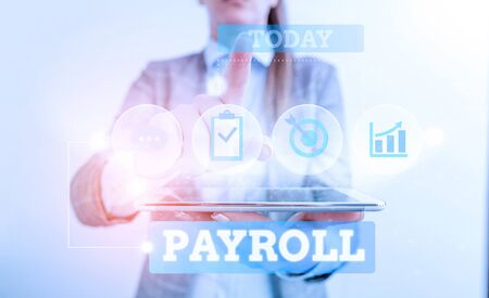 Text sign showing Payroll. Business photo text Amount of wages and salaries paid by a company to its employees Female human wear formal work suit presenting presentation use smart device Stock Photo