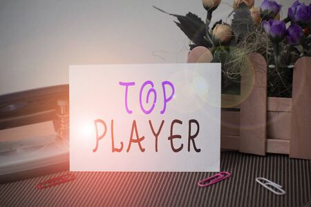 Text sign showing Top Player. Business photo text being best in sports game like football or electronic ones Flowers and writing equipments plus plain sheet above textured backdrop