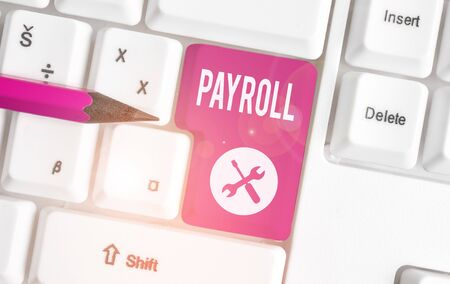 Text sign showing Payroll. Business photo showcasing Amount of wages and salaries paid by a company to its employees White pc keyboard with empty note paper above white background key copy space