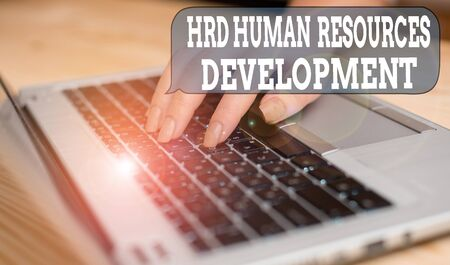 Writing note showing Hrd Huanalysis Resources Development. Business concept for helping employees develop demonstratingal skills woman with laptop smartphone and office supplies technology Stockfoto
