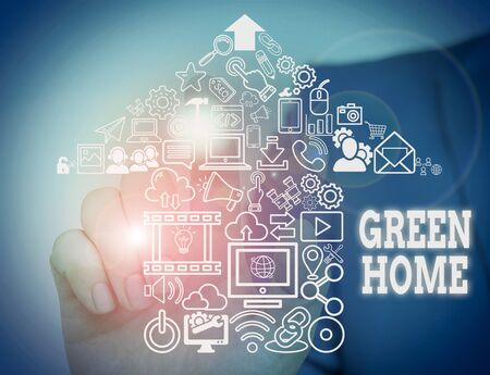 Conceptual hand writing showing Green Home. Concept meaning An area filled with plants and trees where you can relax Male wear formal suit presenting presentation smart device Stok Fotoğraf