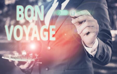 Text sign showing Bon Voyage. Business photo showcasing used express good wishes to someone about set off on journey Male human wear formal work suit presenting presentation using smart device