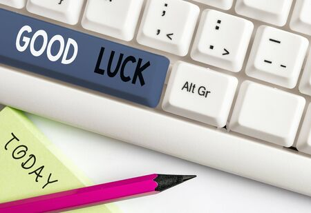 Writing note showing Good Luck. Business concept for A positive fortune or a happy outcome that a demonstrating can have White pc keyboard with note paper above the white background Фото со стока