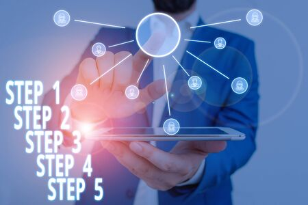 Word writing text Step 1, 2, 3, 4 and 5. Business photo showcasing Steps levels of a process work flow Male human wear formal work suit presenting presentation using smart device