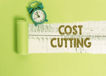 Handwriting text writing Cost Cutting. Conceptual photo actions taken to reduce the amount that is spent on a service