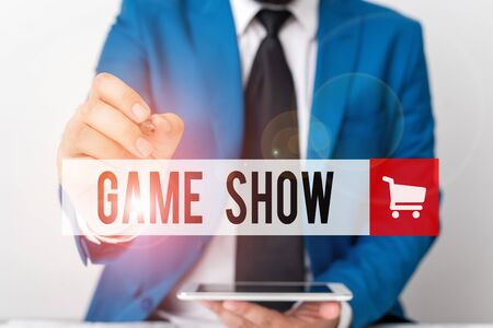 Word writing text Game Show. Business photo showcasing Program in television or radio with players that win prizes Businessman pointing with pen in empty copy space