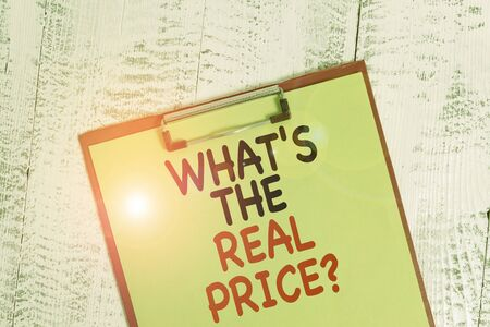 Word writing text What S The Real Price Question. Business photo showcasing Give actual value of property or business Colored clipboard blank paper sheet old retro wooden vintage background
