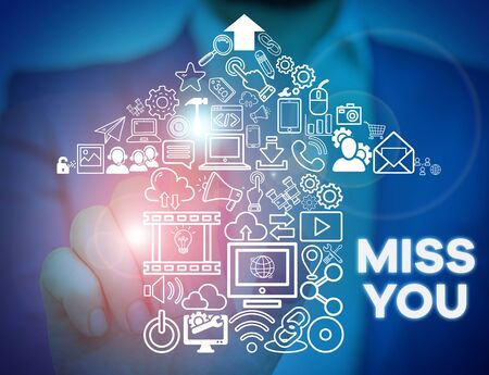 Text sign showing Miss You. Business photo showcasing Longing for an important demonstrating in your life for a period of time Male human wear formal work suit presenting presentation using smart device