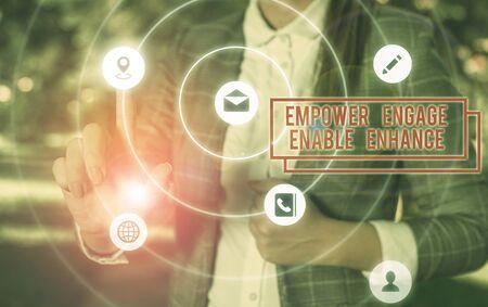 Handwriting text writing Empower Engage Enable Enhance. Conceptual photo Empowerment Leadership Motivation Engagement Stock Photo