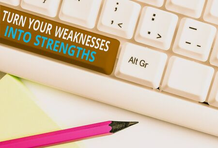 Writing note showing Turn Your Weaknesses Into Strengths. Business concept for work on your defects to get raid of them White pc keyboard with note paper above the white background