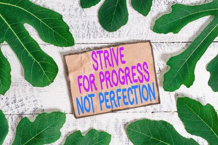 Writing note showing Strive For Progress Not Perfection. Business concept for Improve with flexibility Advance Grow