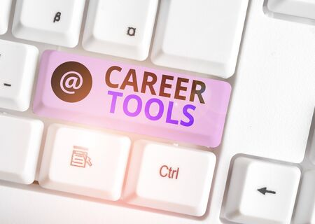 Word writing text Career Tools. Business photo showcasing the system designed to assist and enhance your career White pc keyboard with empty note paper above white background key copy space Stock Photo
