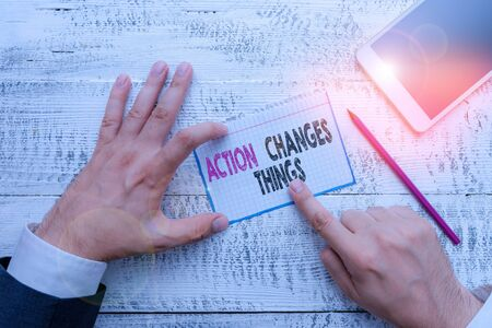 Writing note showing Action Changes Things. Business concept for doing something will reflect other things Reaction