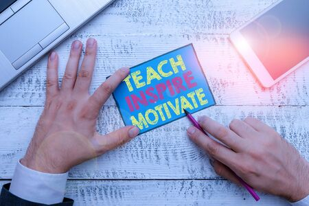 Writing note showing Teach Inspire Motivate. Business concept for Spark the Imagination to Feel the need to Learn Stok Fotoğraf