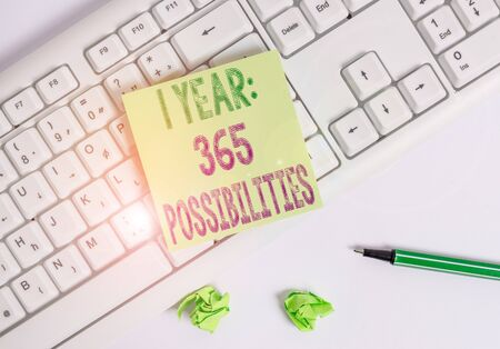 Writing note showing 1 Year 365 Possibilities. Business concept for Beginning of a New Day Lots of Chances to Start Green note paper with pencil on white background and pc keyboard
