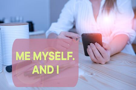 Writing note showing Me Myself And I. Business concept for used by speaker to refer to herself as the object of a verb woman using smartphone and technological devices inside the home 스톡 콘텐츠 - 131076886