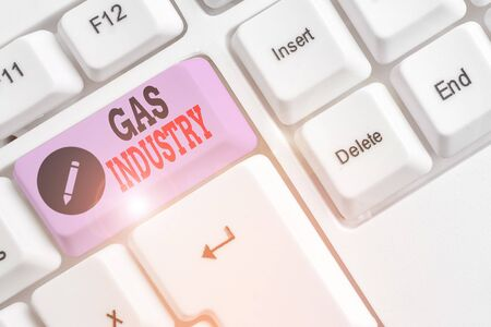 Text sign showing Gas Industry. Business photo text global processes exploration and selling of petroleum products White pc keyboard with empty note paper above white background key copy space