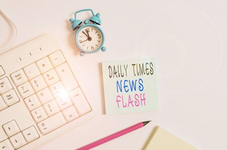 Conceptual hand writing showing Daily Times News Flash. Concept meaning fast response to actions happened in article way Keyboard with empty note paper and pencil white background