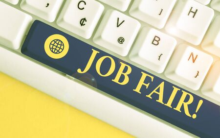 Text sign showing Job Fair. Business photo showcasing event where employers offer information about their companies White pc keyboard with empty note paper above white background key copy space