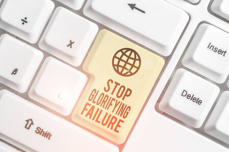 Writing note showing Stop Glorifying Failure. Business concept for do not let Breakdown Rule your life Try again White pc keyboard with note paper above the white background
