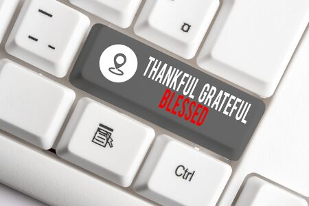 Conceptual hand writing showing Thankful Grateful Blessed. Concept meaning Appreciation gratitude good mood attitude White pc keyboard with note paper above the white background