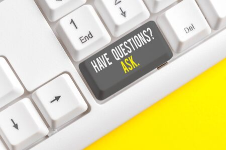 Conceptual hand writing showing Have Questions Question Ask. Concept meaning asking someone respond you with feedback White pc keyboard with note paper above the white background Фото со стока