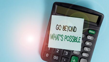 Text sign showing Go Beyond What S Possible. Business photo showcasing do bigger things You can reach dreams Portable electronic calculator device blank sticky note colored background