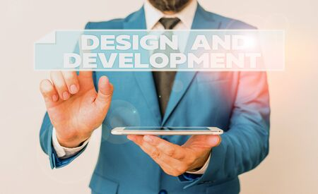 Handwriting text Design And Development. Conceptual photo Defining the Specification of Products and Services Businessman with pointing finger in front of him Stok Fotoğraf