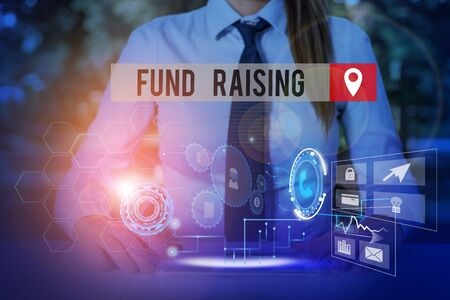 Handwriting text Fund Raising. Conceptual photo the act of seeking to generate financial support for a charity Woman wear formal work suit presenting presentation using smart device