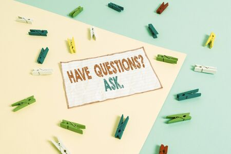 Conceptual hand writing showing Have Questions Question Ask. Concept meaning asking someone respond you with feedback Colored clothespin paper reminder with yellow blue background Фото со стока