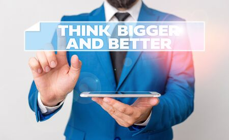 Handwriting text Think Bigger And Better. Conceptual photo no Limits be Open minded Positivity Big Picture Businessman with pointing finger in front of him