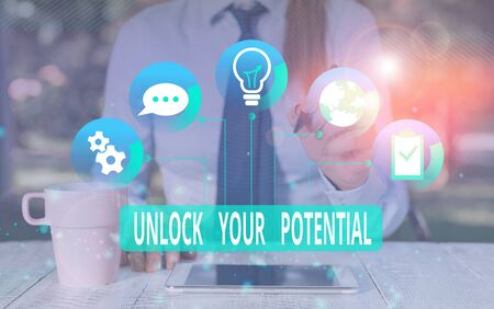 Text sign showing Unlock Your Potential. Business photo text improve self awareness Skills to Achieve more Female human wear formal work suit presenting presentation use smart device Imagens